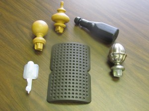Knee Pad (Military), Fluid Reservoir (little white piece)Ornamental Pieces (end of drapery rods) -- Housing Industry